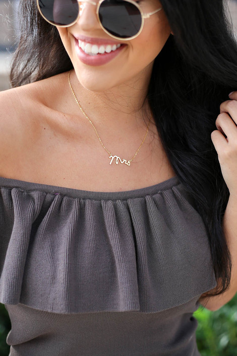 """Gold - necklace with cursive """"Mrs"""" connector on Model"""