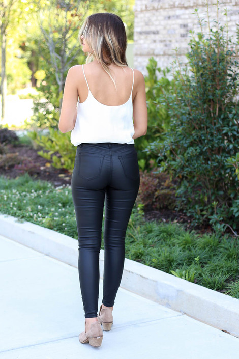 Model wearing Black Vegan Leather Skinny Jeans Back View