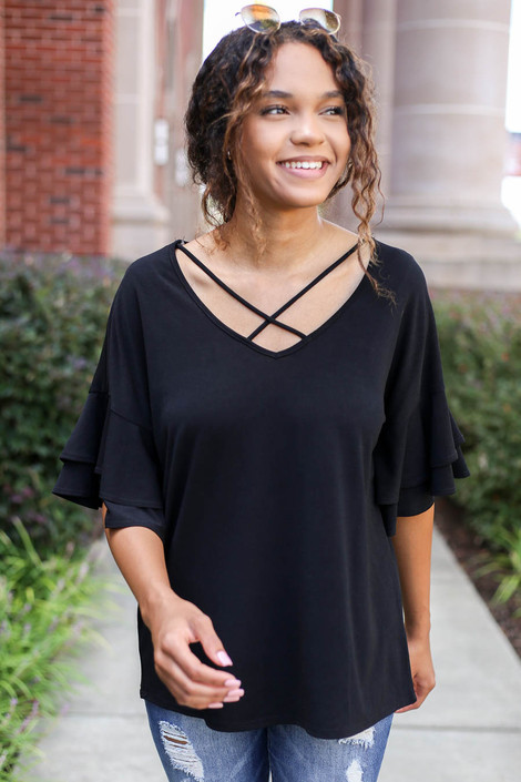 Model wearing Black Criss Cross Ruffle Sleeve Top Front View