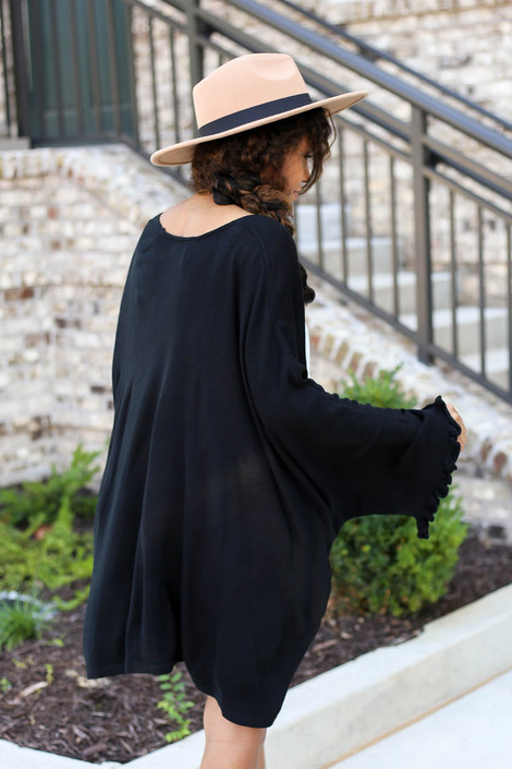 Model wearing Black Oversized Ruffled Cardigan Back View