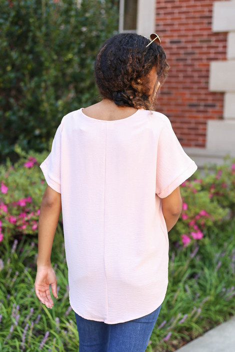 Model wearing Blush Scoop Neck Blouse Back View