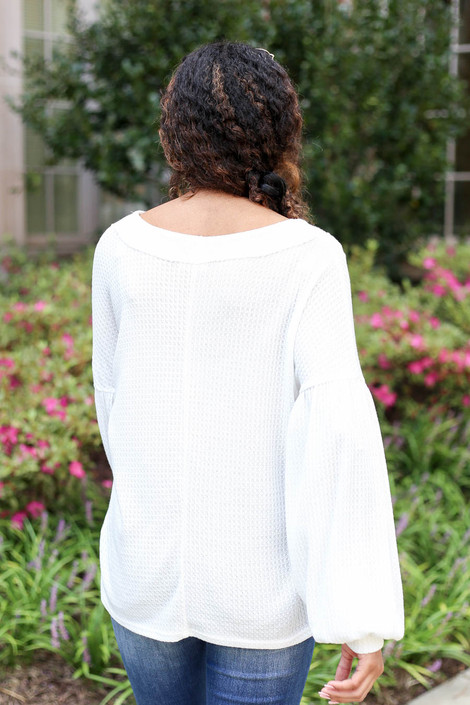 Model wearing White Balloon Sleeve Waffle Knit Top Back View