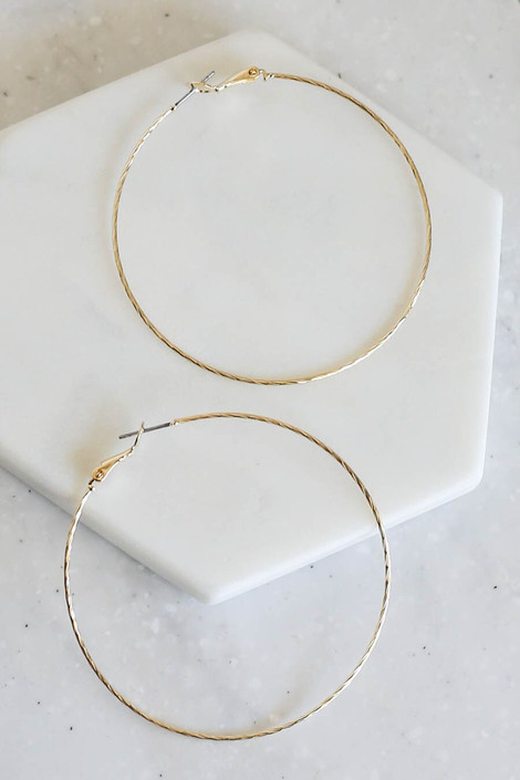Gold - Twisted Hoops on Flat Lay