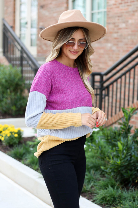 Model wearing Multi Color Ribbed Color Block Knit Top Side View