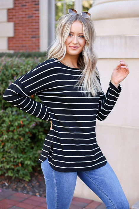 Model wearing Black and White striped Basic Tee Side View