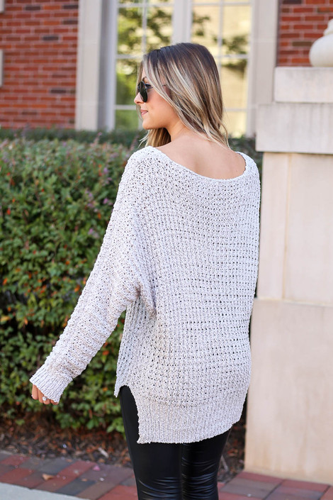 Model wearing Grey Oversized Knit Sweater Back View