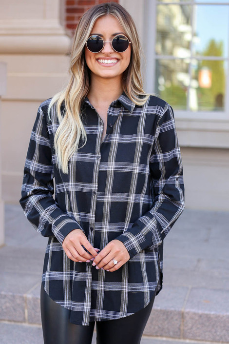 Model wearing Black and White Plaid Flannel