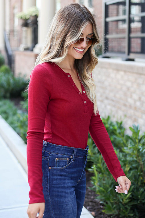 Model wearing Burgundy Button Front Ribbed Knit Bodysuit