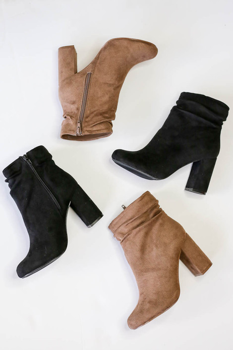 Flat Lay of Black and Taupe Block Heel Slouch Booties