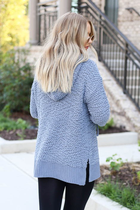 Model wearing Denim Oversized Popcorn Knit Hoodie Back View