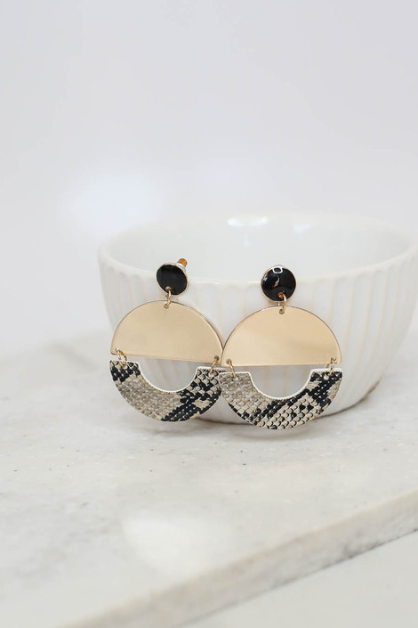 Snake - and Gold Geometric Earrings on Bowl