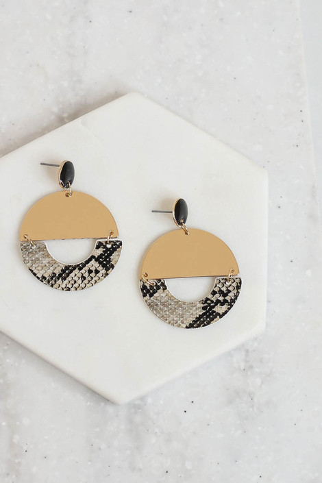 Snake - and Gold Geometric Earrings Flat Lay