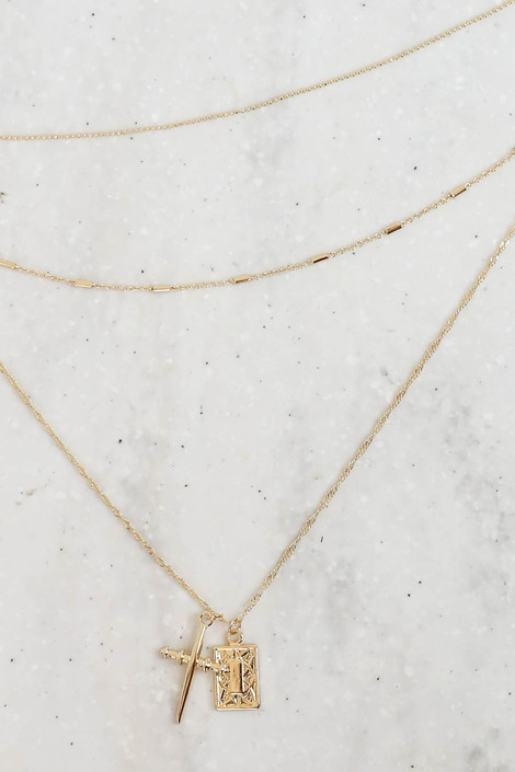 Gold - Cross and Pendant Tri-Layer Necklace Flat Lay