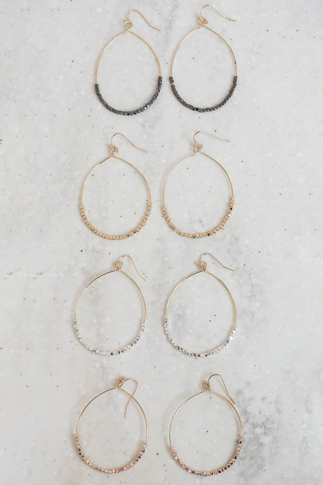 Gold,  Silver, Black and Rose Gold Beaded Earrings Flat Lay