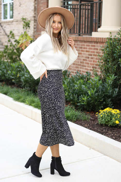 Model wearing Black Spotted Midi Skirt Side View