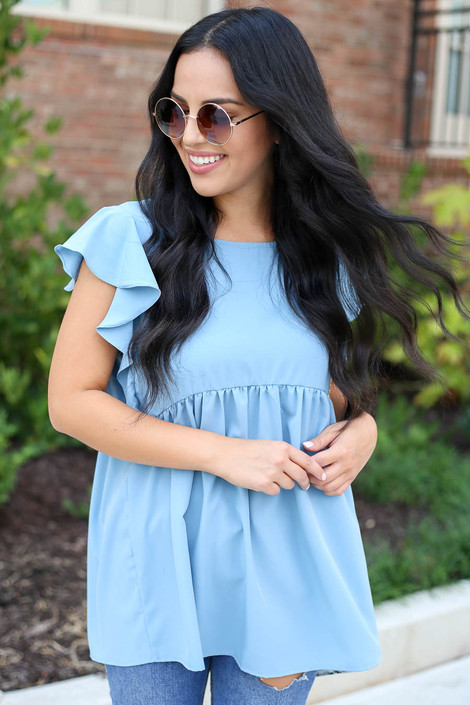 Model wearing Denim Flutter Sleeve Blouse