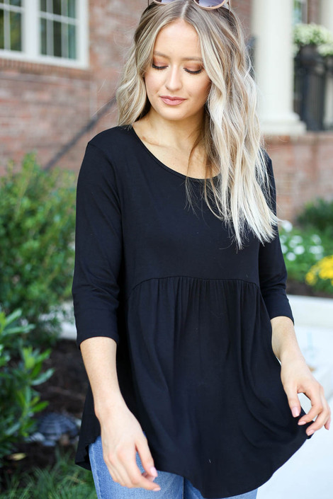 Model wearing Black 3/4 Sleeve Babydoll Top