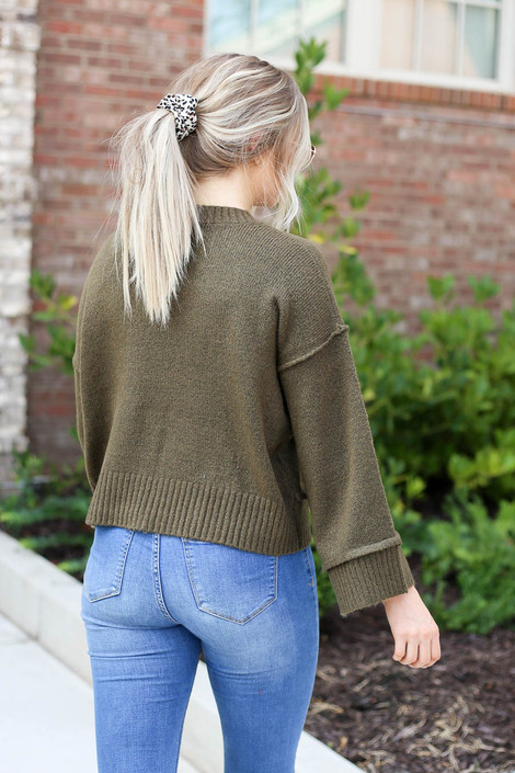Model wearing Olive Wide Sleeve Sweater Back View