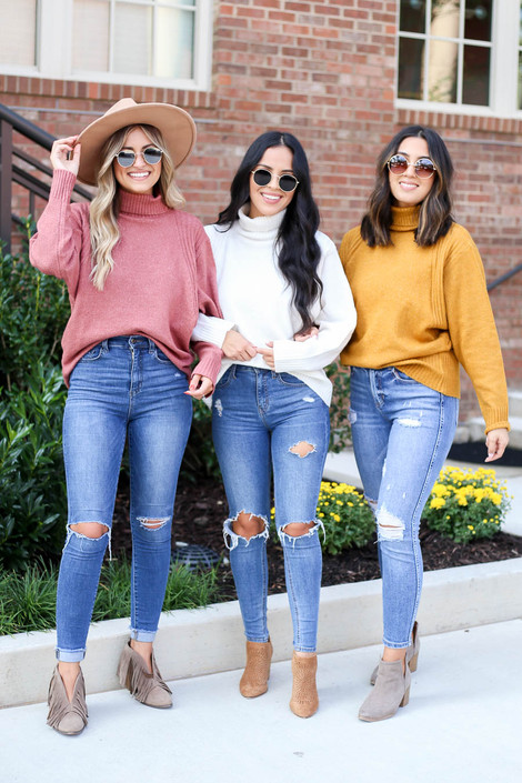 Models wearing Ivory, Mustard, and Blush Turtleneck Sweaters
