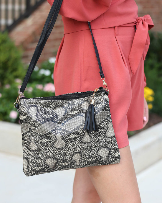 Ivory - Ansley Oversized Snakeskin Clutch with cross body removable strap with Model