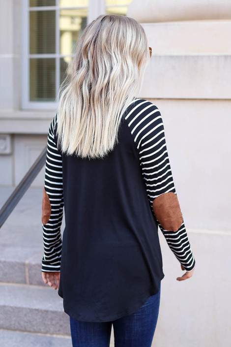 Model wearing Black Striped Elbow Patch Top Back View