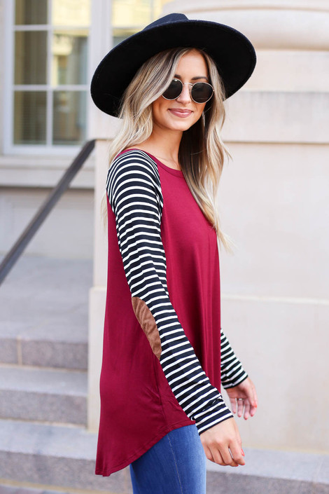 Model wearing Burgundy Striped Elbow Patch Top Side View