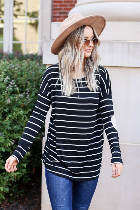 Model wearing Black and White Striped Elbow Patch Top