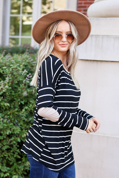 Model wearing Black and White Striped Elbow Patch Top Side View