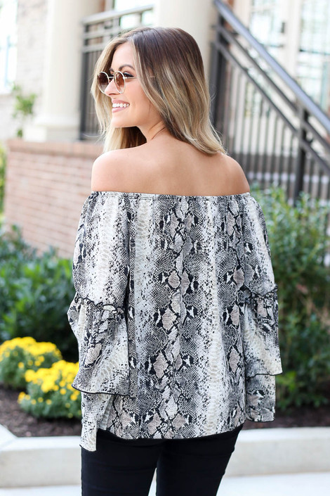 Model wearing Snakeskin Print Off the Shoulder Ruffle Sleeve Blouse Back View