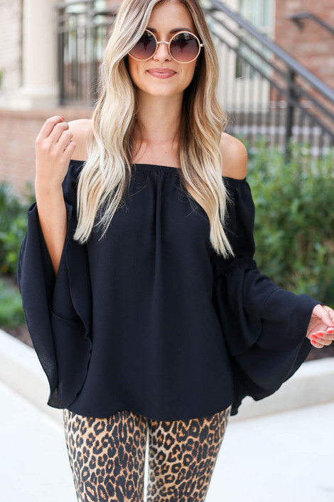 Model wearing Black Off the Shoulder Tiered Blouse Front View