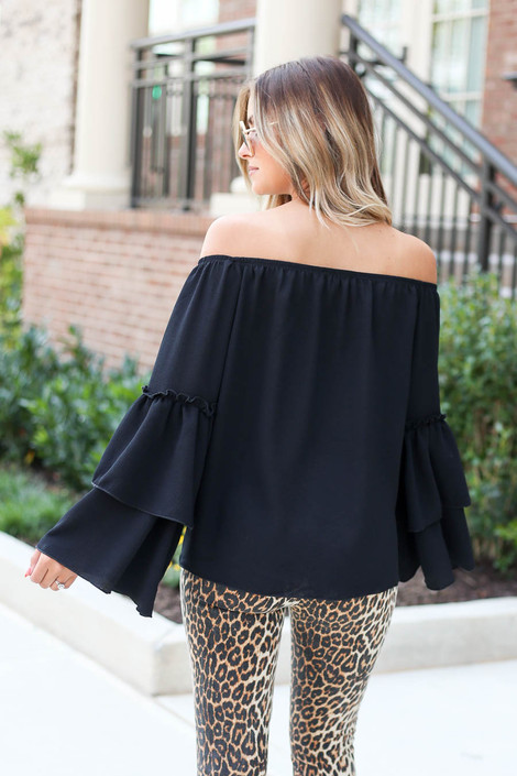Model wearing Black Off the Shoulder Tiered Blouse Back View