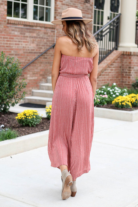 Model wearing Rust Striped Strapless Wide-Leg Jumpsuit Back View