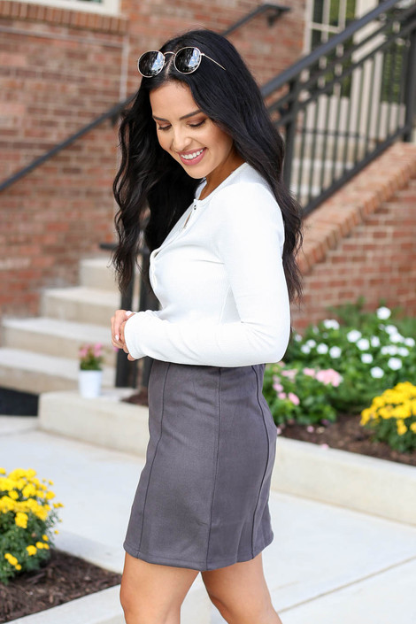 Model wearing Charcoal Exposed Seam Mini Skirt Side View