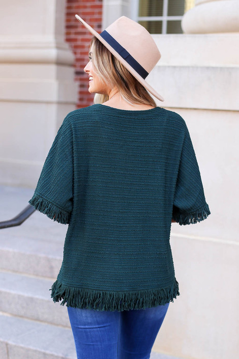 Model wearing Green Fringe Textured Top Back View