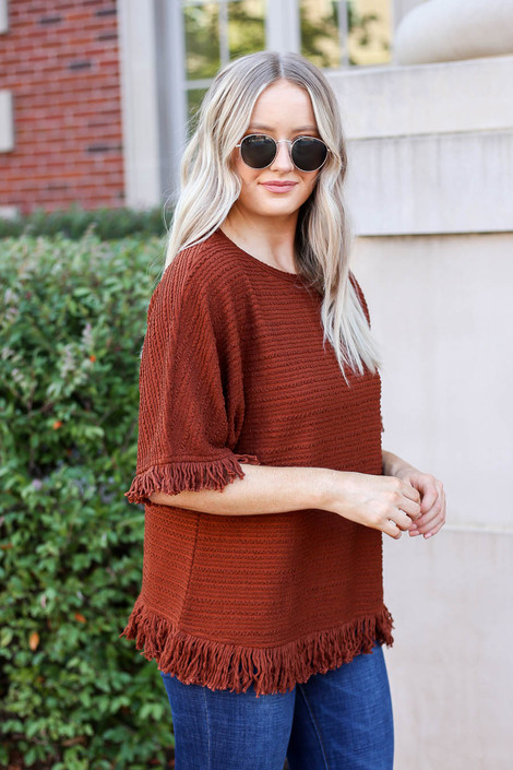 Model wearing Rust Fringe Textured Top Side View