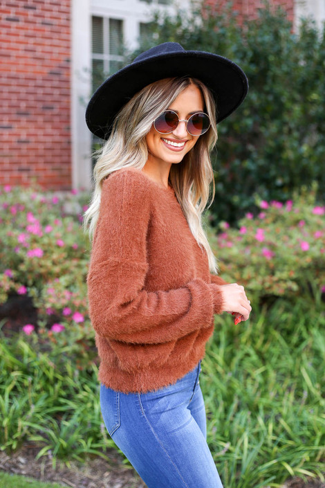 Model wearing Rust Fuzzy Knit Sweater Side View
