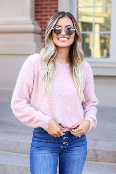Model wearing Pink Fuzzy Knit Sweater