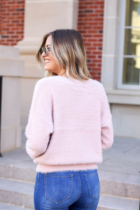 Model wearing Pink Fuzzy Knit Sweater Back View