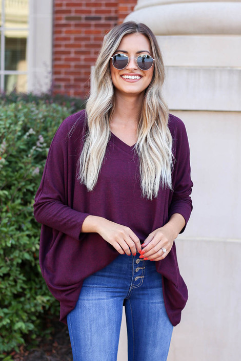 Model wearing Burgundy Soft Knit Top Tucked In