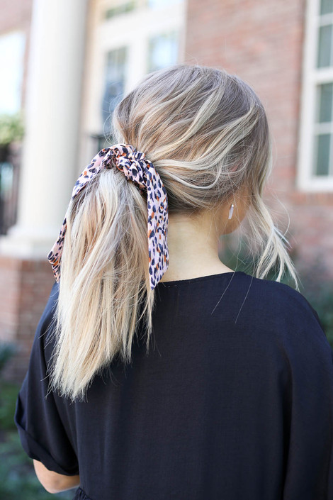 Blush - pink spotted scrunchie scarf on model