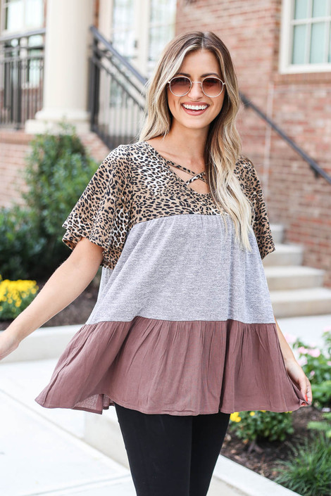 Model wearing Grey Criss Cross Leopard Print Color Block Top from Dress Up Side View