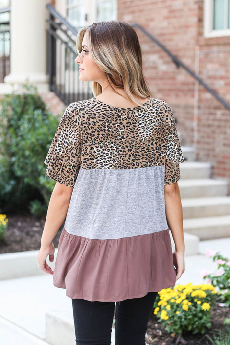 Model wearing Grey Criss Cross Leopard Print Color Block Top from Dress Up Back View