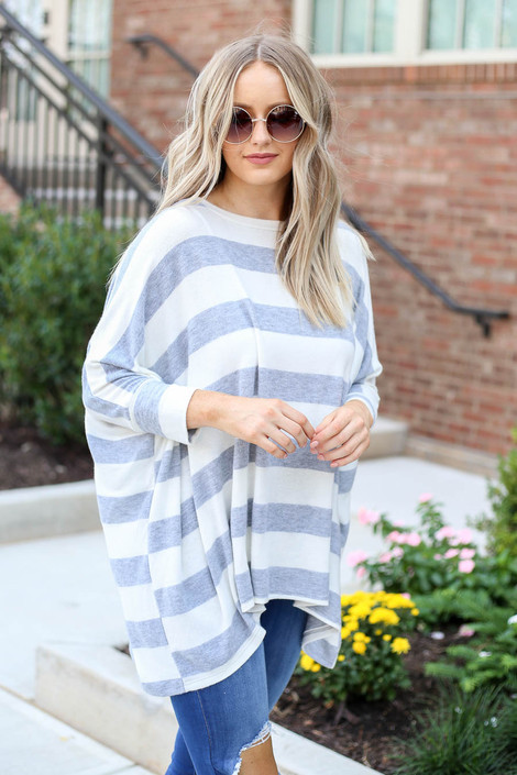 Model wearing  Lyla Striped Oversized Knit Top- front angle view