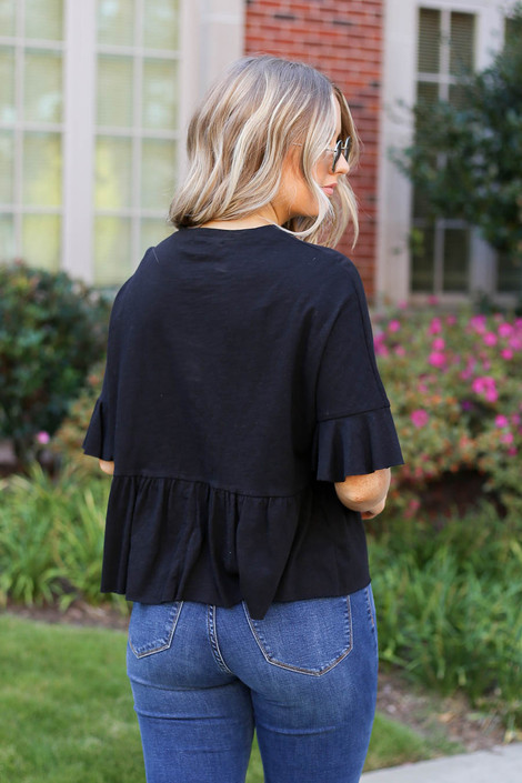 Model wearing Black Ruffle Sleeve Babydoll Top from Dress Up Back View