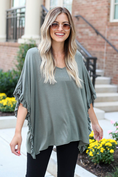 Model wearing Olive Oversized Ruffle Tee from Dress Up