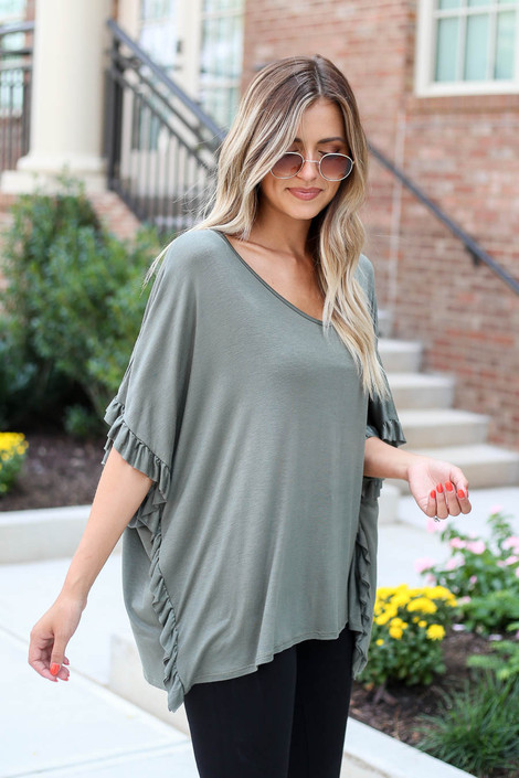 Model wearing Olive Oversized Ruffle Tee from Dress Up Side View