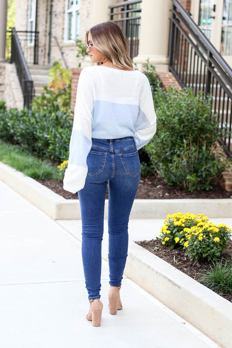 Model wearing Medium Wash Distressed High-Rise Jeans Back View