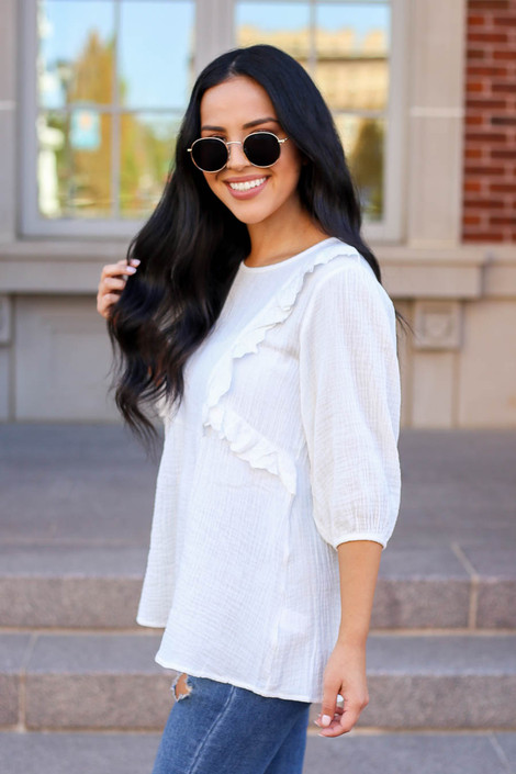 Model wearing White Embroidered Ruffle Blouse From Dress Up Side View