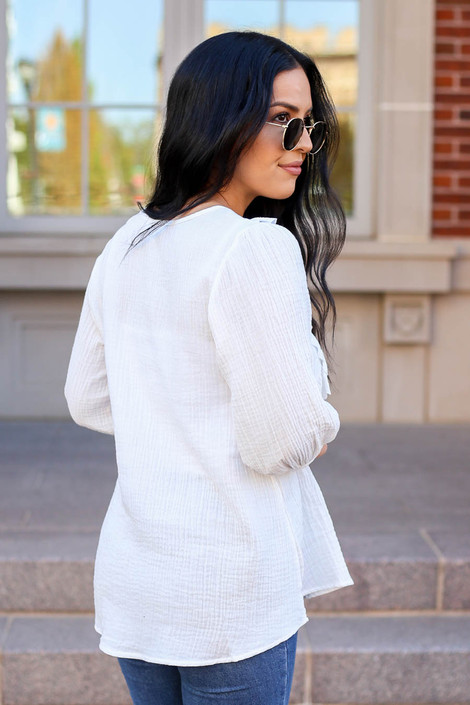 Model wearing White Embroidered Ruffle Blouse From Dress Up Back View