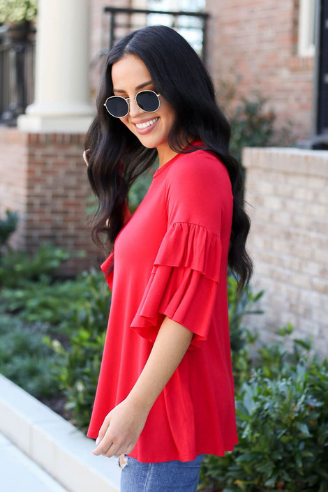 Red - Model wearing the Neely Tiered Sleeve Top in red- side view